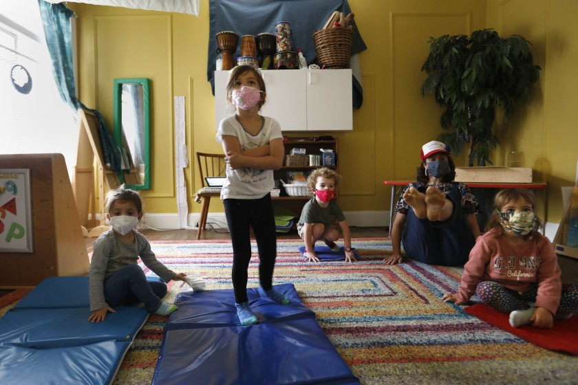 Kirsten Hove, second from right, leads preschoolers in stretching exercises.