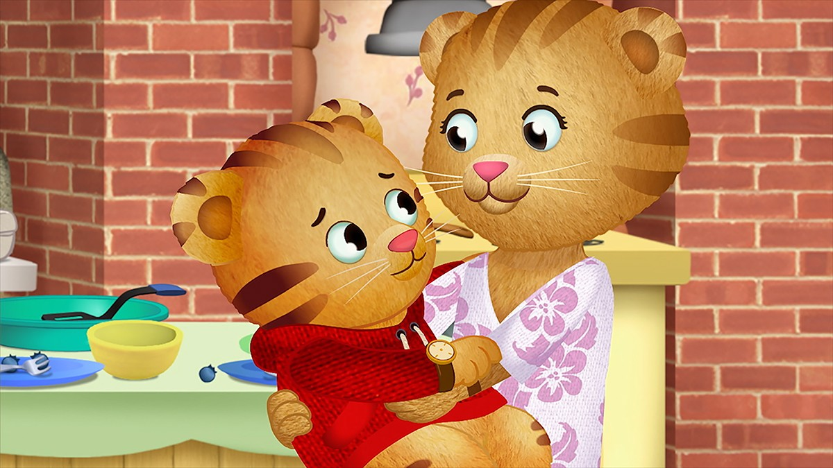 Cartoon of a mom tiger holding a baby tiger in her arms as they look at each other.