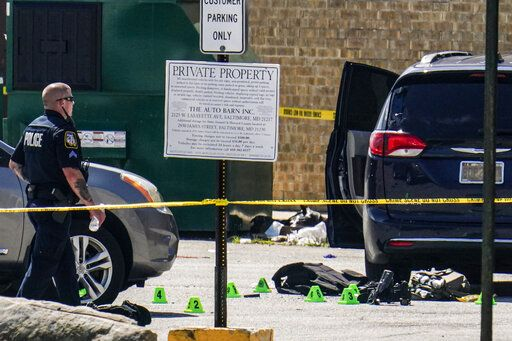 Body armor is seen near a minivan in a parking lot area of a mall where two officers on the U.S. Marshals' task force where allegedly shot in Baltimore, according to officials, Tuesday, July 13, 2021. The Marshal's wounds aren't thought to be life-threatening.